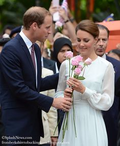 SUCH a Romantic!! With a gentle and reassuring touch, William hands roses to his beloved.