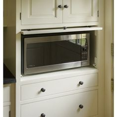 I love the idea of hiding the microwave.  Other small appliances too.  Would want them to be plugged in and able to operate in place.  Maybe roll out on a shelf like TVs sometimes do?