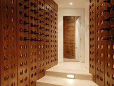 Great wine cellar design incorporating wood element and riddling racks inspiration