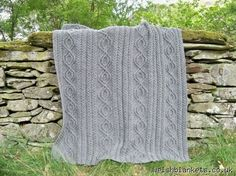 I would LOVE to have this blanket. I want to cuddle with it. It's handmade cable knitted made of Welsh wool... *happy sigh*