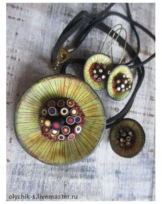 "Domed disks are proliferent in our chosen media, polymer clay. In this blog post, we feature an example of disks by Russian artist, Olga Sypkova. She calls these ""Mars Flowers"". Take a closer look at The Polymer Arts Blog, http://www.thepolymerarts.com/blog/10033"