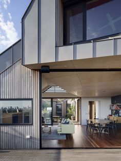 Zinc panels form an undulating roof for this hilltop house by Gardiner Architects, which overlooks the Australian city of Melbourne.