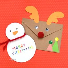 トナカイと雪だるまのクリスマスカード