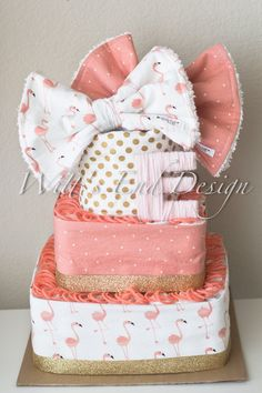 Such a fun pink, coral and gold Flamingo diaper cake. **PLEASE LEAVE DATE YOU NEED CAKE IN NOTES TO SELLER AT CHECKOUT**** This original diaper cake is created using 80 individually rolled size 1 Pampers diapers, 3 cotton chenille burp cloths (shown in 2nd and 3rd pic). We use