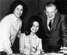 With sister, Peggy Sue, and Owen Bradley, as Peggy Sue signs her contract with Decca Records in 1969.