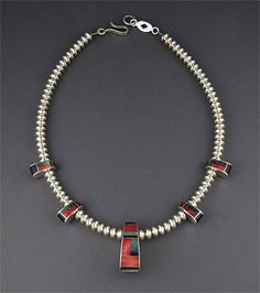 Reversible Necklace | Benson Manygoats (Navajo).  Sterling silver handmade beads combined with sterling silver inlaid with shell, jet and coral elements.