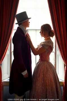 www.arcangel.com - victorian-couple-getting-ready-before-a-window