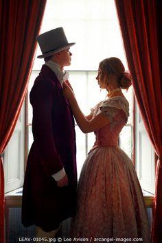 www.arcangel.com - victorian-couple-getting-ready-before-a-window
