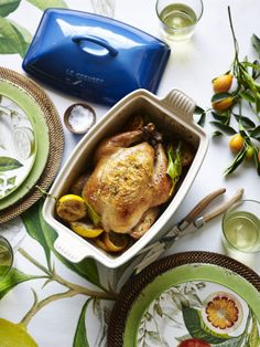 Roasting a whole chicken alongside fragrant lemons adds a fresh springtime twist to a comforting main dish.
