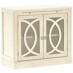 Biblioteca Antique White 2-Door Cabinet Base.  Off-white might make a nice contrast to the brown furniture in the family room, and echo the fireplace mantel, trim around the sliding glass door (and potential drapery panels).  $499, Pier One.