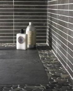 Use Flat Pebble Mosaic Tile To Create A Border For Your Shower Floor.