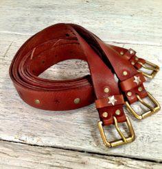super soft veg tan leather belt. Tan or black features stars and rivetsS. 90cm  M. 95cm  L. 100cmHandmade