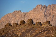 The landscape in Oman.  This is the UNESCO World Heritage site Al Ayn in Oman. These beehive caves date back 5000 years, they are easy to spot from the road if you look carefully.