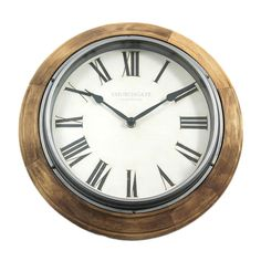 This wood-edged circular wall clock features chunky black Roman numerals set against a cream background. Kitchen Clocks, Clock Display, Copper Accents, Shaker Kitchen, Roman Numerals, Color Splash, Cleaning Wipes, Home Accessories, Quartz
