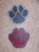 Paw print hama perler beads.  My idea - do a few of these (made out of  cement/beads) in the dirt leading up to Rambler's final resting place.