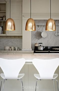 Tip: Hang a pair or trio of hammered pendants over your kitchen island for extra sparkle, Glamour with Hammered Surfaces (Cultivate.com)