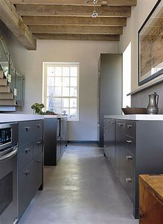 grey + white + wood in rustic modern kitchen design by powell + bonnell