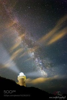 Guardian under the stars  Milky way shot of a lighthouse near Rome. Night was a…