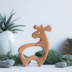 A wooden teether (fox, deer or squirrel) made of beech and covered with linseed oil is the ideal first toy for babies to grasp and chew. Sanded perfectly smooth. A unique gift for new parents and their new little ones. The price is given for one teether. MATERIALS: beech SIZE: fox: 9 cm х 7 cm х 1,5 cm deer: 9 cm х 8,5 cm х 1,5 cm squirrel: 9,5 cm х 9,5 cm х 1,5 cm  100% handmade.  AGE: 0+ YEAR  Fabric bag included. Thank you for your visit! See other natural wooden toys…