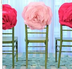 Tissue flowers attached to back of chairs