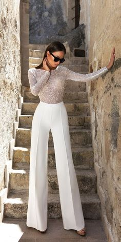 The Hottest New Year's Eve Outfits For 2018 is part of Pantsuit wedding dress - These New Year's Eve outfits are going to have you looking hot at your New Year's party! Here are our favorite New Year's Eve looks! Pantsuit Wedding Dress, Fall Wedding Dresses, Wedding Gowns, Bridal Jumpsuit, Wedding Pants Outfit, Tomboy Wedding Dress, Bridal Pants, Lace Jumpsuit, Jumpsuit Outfit