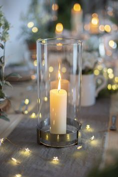 Bring candlelit charm to your home or garden with this handsome hurricane lamp, hand crafted from polished steel, with a cylindrical glass shade. Modern Properties, Hurricane Lamps, Natural Building, Beeswax Candles, Fairy Lights, Metal Working, Im Not Perfect, Table Decorations, Christmas