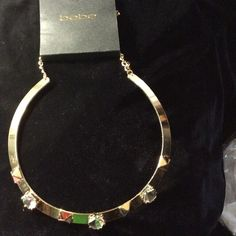 bebe necklace NWT super cool gold collar band Only one left! This is an authentic bebe necklace. Gold color band with studs and  stones with adjustable chain to fit the length you like. Makes an amazing gift at a fraction of the price .100 % authentic. Happy poshing! bebe Jewelry Necklaces