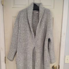 Loft Boucle sweater coat Gently worn warm sweater coat by Loft soft and cuddly great with high or over the knee boot and a plain t shirt for a fashionable statement great for work and casual events. Ann Taylor Jackets & Coats