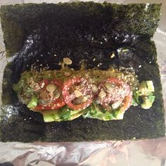 rawveganpreneur#rawvegan nori roll filled with guacamole sprouted Mung bean cheese, marinated mung beans layered on top with sliced tomatoes. #low fat#healthy raw food#healthy#raw vegan#raw vegan living#delicious