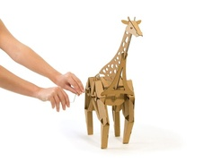 NEW PRODUCT – Geno the Giraffe – Kinetic Creatures. Geno the Giraffe is a walking cardboard animal sculpture that you assemble from pre-cut and scored cardboard pieces. Geno walks when … Cardboard Animals, Cardboard Paper, Wooden Gears, Learning Toys, Animal Sculptures, Diy Toys, Holiday Gift Guide, Cool Toys, New Product