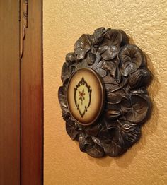 Art piece made from salvaged lamp base and vintage vanity jar lid.