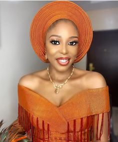 This beautiful bride rocked her burnt orange Asooke in a stylish way. The dress had fringes on it and a beautiful bow just at the back Traditional Wedding Attire, African Traditional Wedding, African Traditional Dresses, African Lace Dresses, African Fashion Dresses, Orange Dress Outfits, Nigerian Lace Styles, African Wedding Attire, Classy Prom Dresses