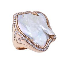 18kt red gold ring featuring a freshwater barroque pearl that is bezel set in a hand carved, high polish frame. There is diamond round accent around the p
