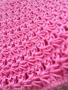 Corpetto con lavorazione a crochet a mano in cotone.