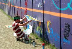DO: Draw something cool on the walls around Bonnaroo.