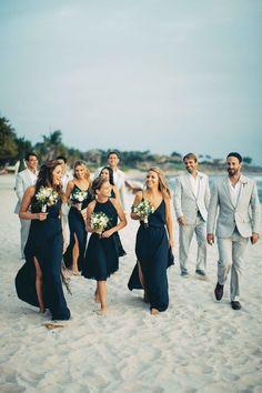 bridesmaids in blue, groomsmen in grey