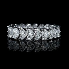 This beautiful 18k white gold eternity wedding band ring features half-moon cut and princess cut white diamonds of F color, VS2 clarity and excellent cut and brilliance, weighing 1.94 carats total.