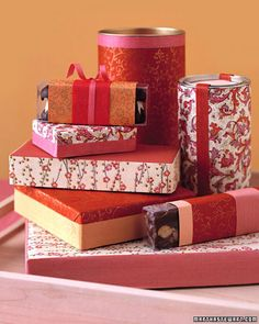Dressed-Up Packaging ~ Ordinary cardboard boxes and metal canisters can easily be turned into beautiful gift containers for homemade candy. Use art paper, wrapping paper, or even wallpaper samples, and use a glue stick or craft glue to adhere the paper to the container.