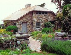 Tor House at Carmel Point in California, overlooking the Pacific Ocean. Tor House was built by Poet Robinson Jeffers (1887-1962) for his wife Una (1884 - 1950) and two twin sons in 1918. Jeffers learned the art of stonemasonry from the builder he hired, laying many rocks in place with his own hands.