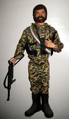 G.I. Joe Action Figure 0188    Classic GI Joe crew cut bearded action figure soldier from 1971 in gorilla warfare gear - guns Joe figure G.I. Joes action figure Vietnam jungle uniform toy toys gun 1970s 70s beard combat War Warfare bullet belt ammo fighter freedom America American man male men camouflage green general issue Hasbro