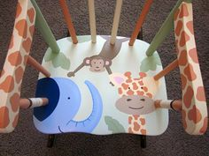 Safari Rocking chair can be personalized with a child's name on the headrest. $150.00 Makes a great gift!