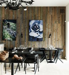 Restaurant in Copenhagen as inspiration for a dining room at home. Big art, reclaimed wood walls, modern furniture and lighting.