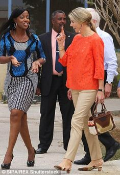 Even Queen Maxima's handbag featured orange embroidery to match her top and earrings...