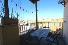 Very colorful and quirky 2 bedroom flat, fitting 3 guests. A wonderful terrasse overlooking the city life!