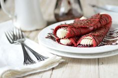 These Red Velvet crepes will satisfy a multitude of cravings with raspberry preserves and a sweet cream cheese filling to the Nutella drizzled over top!