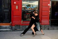 """Dancing in the Street"". Tango performers demonstrate the art of the dance in La Boca, Buenos Aires, Argentina. (Photo and caption by Scott Sleek/National Geographic Traveler Photo Contest)"
