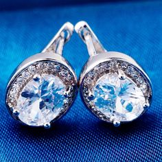 Oval Solitaire Halo Earrings
