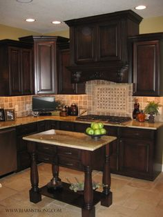 Custom Kitchen Cabinets, Island with Granite Countertops, Tile Backsplash, and Travertine Floors