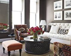 "kilim-covered george smith chairs and a sofa by le décor français in the living room; the walls are painted in benjamin moore's ""clinton brown""."