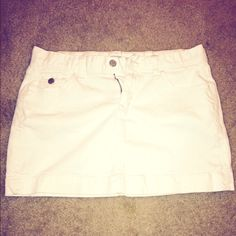 OLD NAVY WHITE DENIM MINI SKIRT Just in time for Fourth of July!!! Old Navy white denim mini skirt. Hits about a little bit higher than mid thigh. Last picture is a good representation of length. Slight pull of stitching on bottom as shown in picture #3 but may be able to be cut, didn't want to change the garment.  Bundle it with the denim mini skirt I'm also selling in my closet. Old Navy Skirts Mini